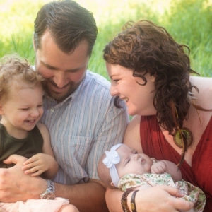 Family with Baby Clara, a newborn born through JoySpring Midwifery with Charge Syndrome