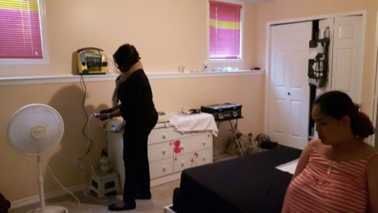 JoySpring Midwife Ola Mebude preparing for birth