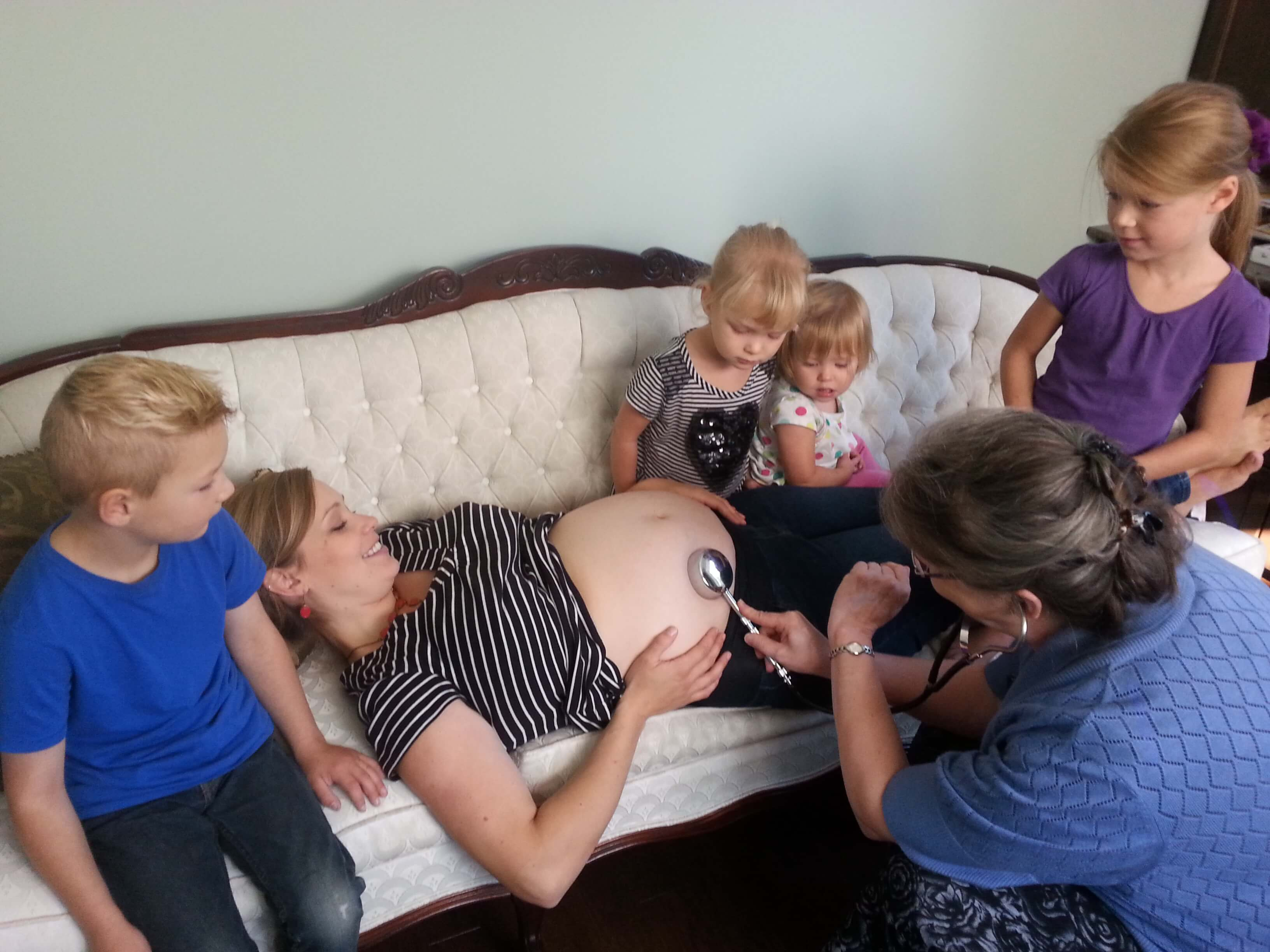 Prenatal appointment at JoySpring Midwifery with Cathy Harness and siblings