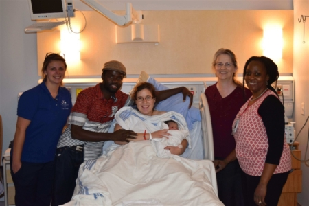 Baby Kezia with proud parents and JoySpring midwives