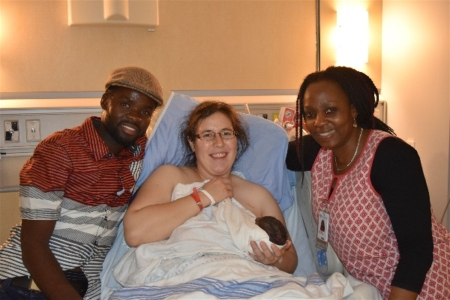 Baby Kezia with parents and midwife Ola Mebude