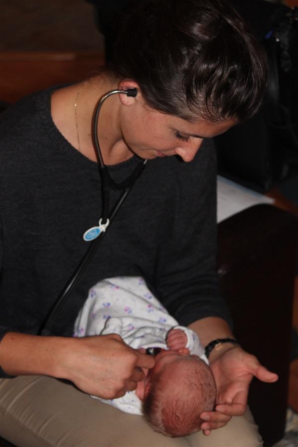 JoySpring student midwife examining newborn