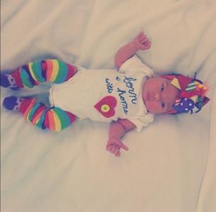 Baby Freya wearing born at home onesie