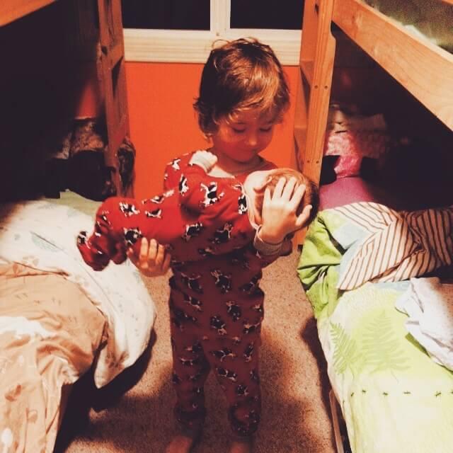 Baby Mauve being held by older sibling wearing matching pyjamas
