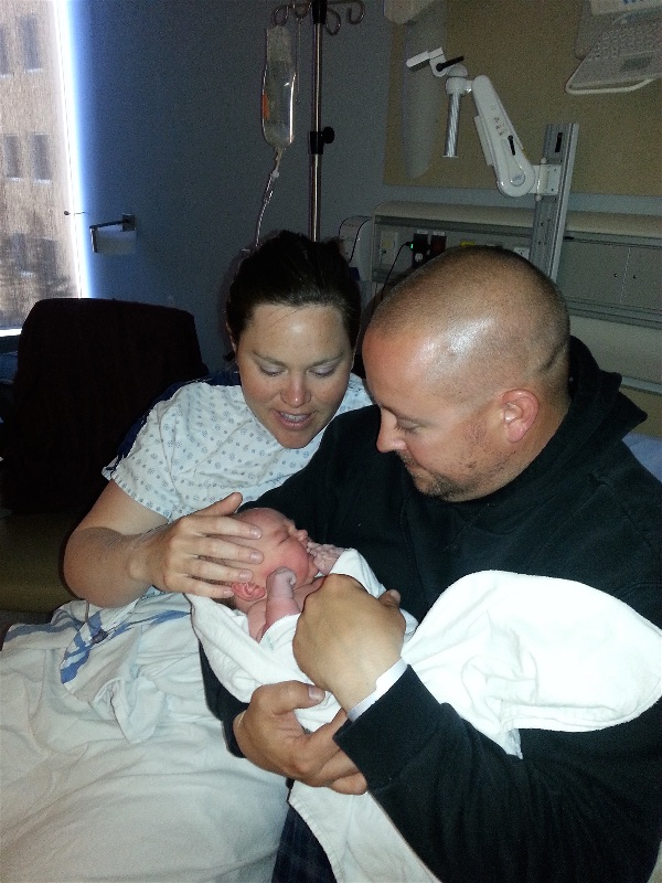 Baby Avaiah with mother and dad in hospital room