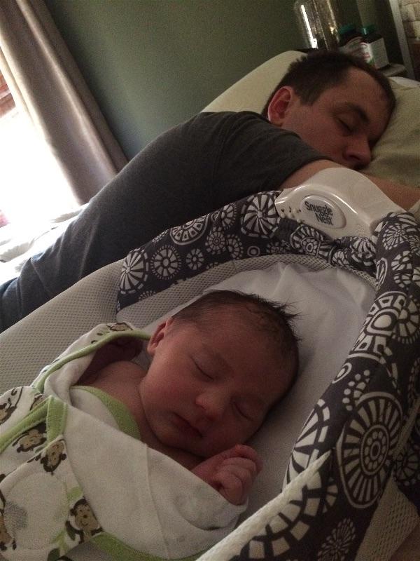 Newborn baby Emilia and daddy resting