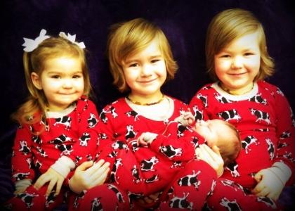 Baby Mauve and siblings wearing matching pyjamas